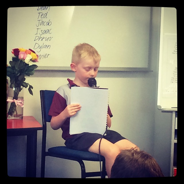 I very nervous little guy reading his story to a room of his peers and parents. Well Done Ben x