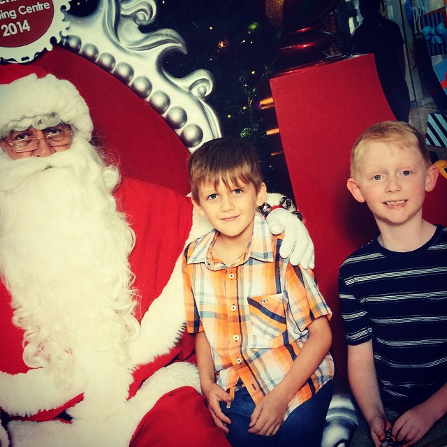 The yearly Santa shot. Ben wasn't sitting anywhere near Santa. Lucky Ted saved the day.