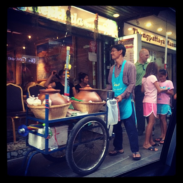 Sitting in a traffic jam looking out the window ...... massage ladies, street vendor, children playing