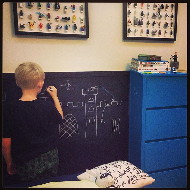 Ben drawing on his chalk boards!