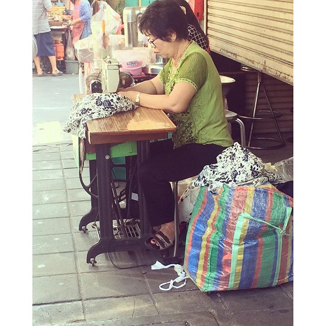 Another pic of everyday Thailand. This lady works on the street everyday. It is not unusual to see her customers  changing clothes on the street so she can pin the alterations.