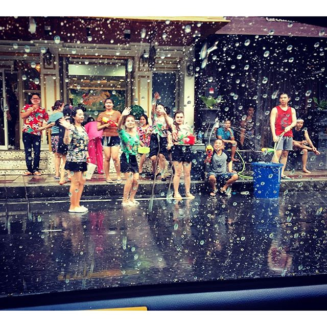 You can't walk down our Soi without getting wet. I'm nice and dry in the taxi. Happy Songkran!