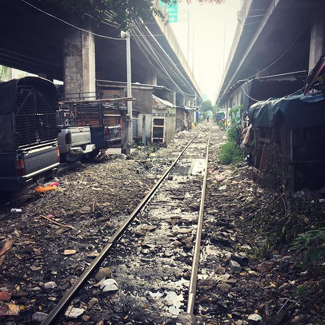 Railway line through the slum. Above is the highway.