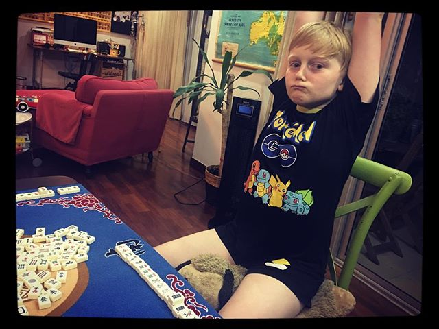 Ben's first Mahjong win! Apparently that's a victory face
