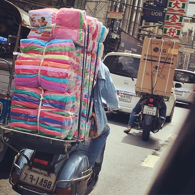 Motorbikes can carry anything....a washing machine  and an enormous  stack of towels!  I love China town ️