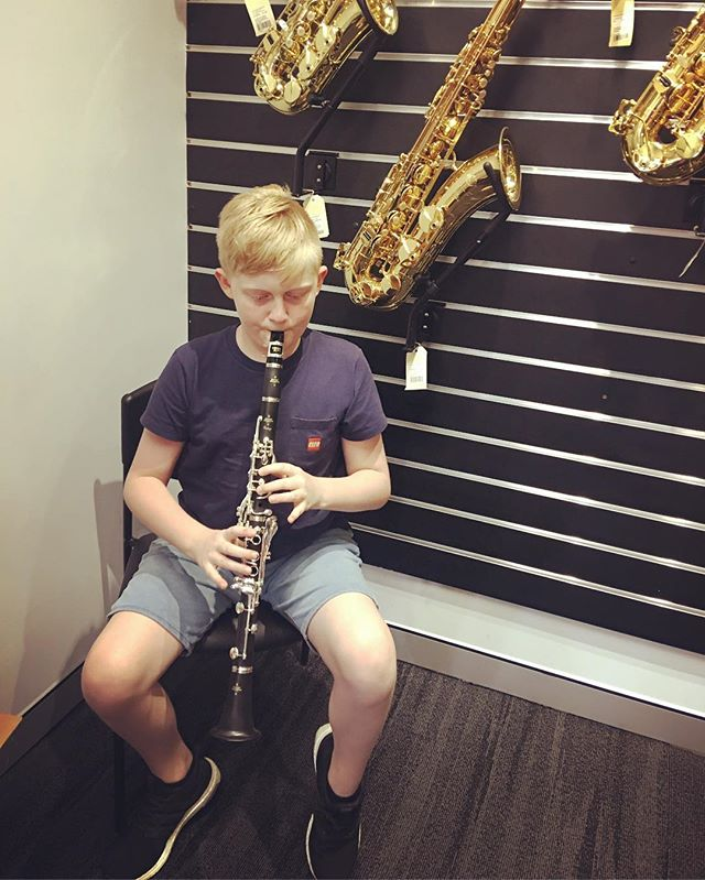 Shopping for Ben's very own clarinet. He is seriously happy!