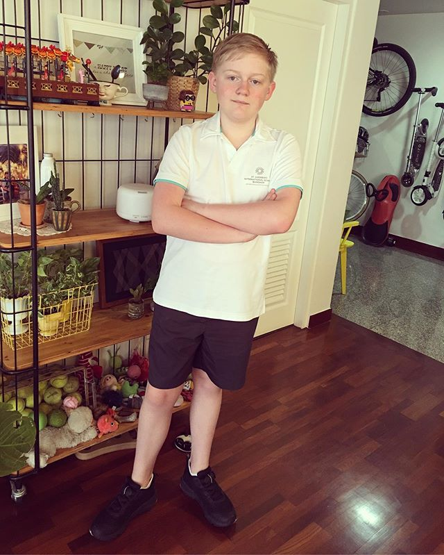 First Day of High School. He reluctantly stood for a photo.  All smiles and a little bit of nerves when he left on the bus.  He told me he didn't need me to go with him.  However he did pop back to see me while he waited for the lift. He gave me a big cuddle and told me not to cry ️ #growinguptoofast